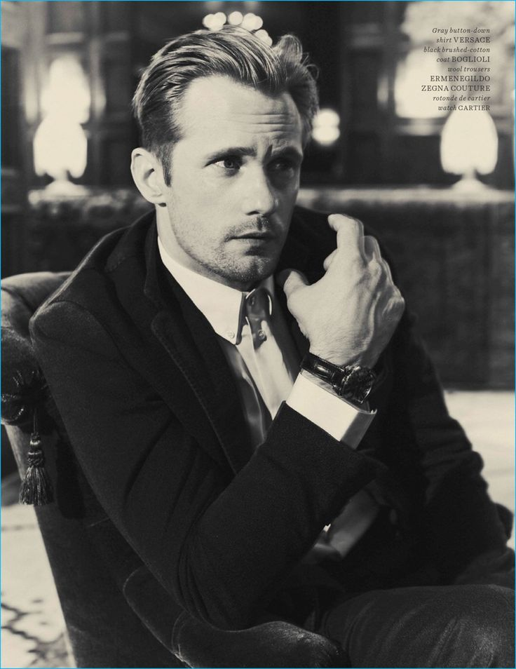 Guy Aroch photographs Alexander Skarsgård in a Versace shirt, Boglioli coat, Cartier watch, and Ermenegildo Zegna Couture wool trousers.