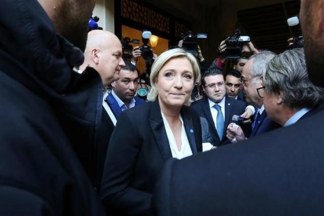 Marine Le Pen, French National Front (FN) political party leader and candidate for French 2017 presidential election, leaves after rejecting a headscarf for her meeting Lebanon's Grand Mufti Sheikh Abed el-Lateef Daryan, in Beirut, Lebanon February 21, 2017. REUTERS/Aziz Taher