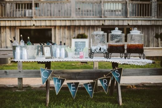 "Simple self-serve bar setup for rustic wedding, DIY ""cheers"" banner  www.neverseriousblog.com www.allisonharp.com"