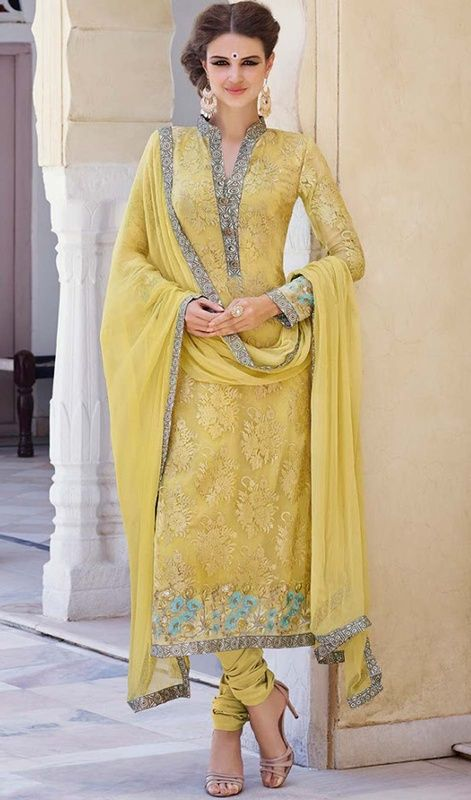 Score a perfect look with this India churidar kameez in yellow color embroidered georgette. The ethnic lace and resham work with dress adds a sign of attractiveness statement with a look. #yellowshadesalwarkameez #churidardress #indianstylesuit
