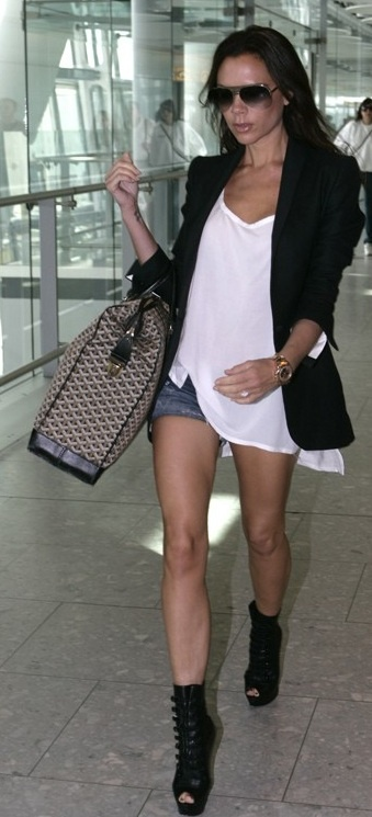 Who made Victoria Beckham's sunglasses, black boots, and watch that she wore in Heathrow airport on September 3, 2010?