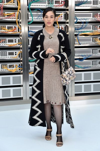 Chelsea Islan attends the Chanel show as part of the Paris Fashion Week Womenswear Spring/Summer 2017 on October 4, 2016 in Paris, France.