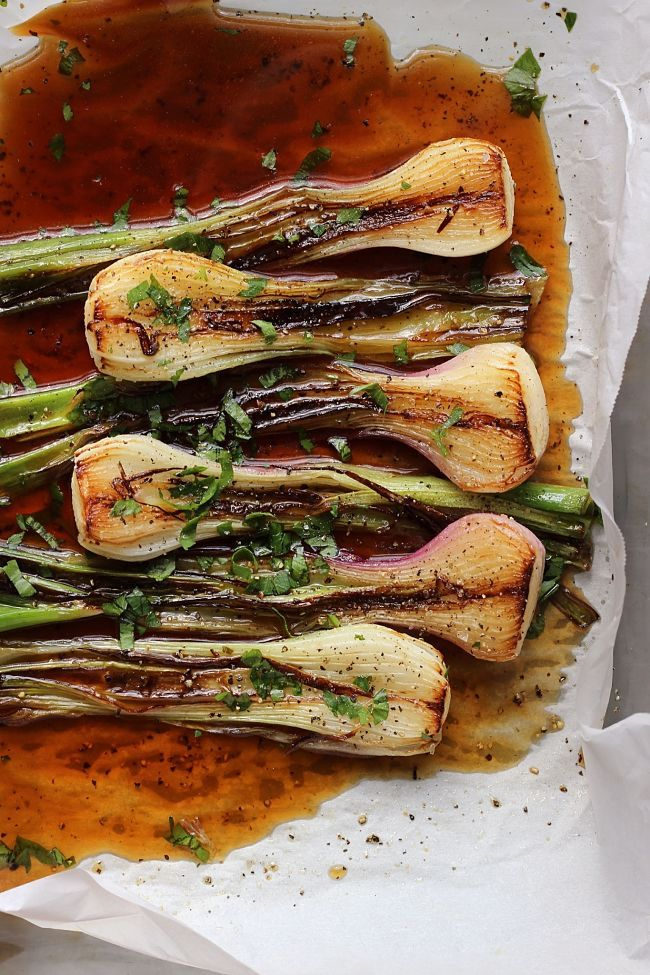 These espresso-braised spring onions are great as a side dish, but even better chopped up and tossed with pasta and other vegetables.