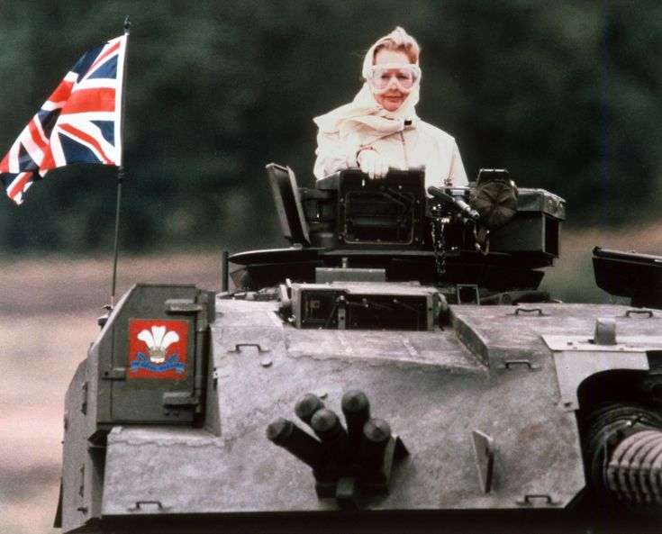 English Prime Minister Margaret Thatcher riding in a tank in 1986.