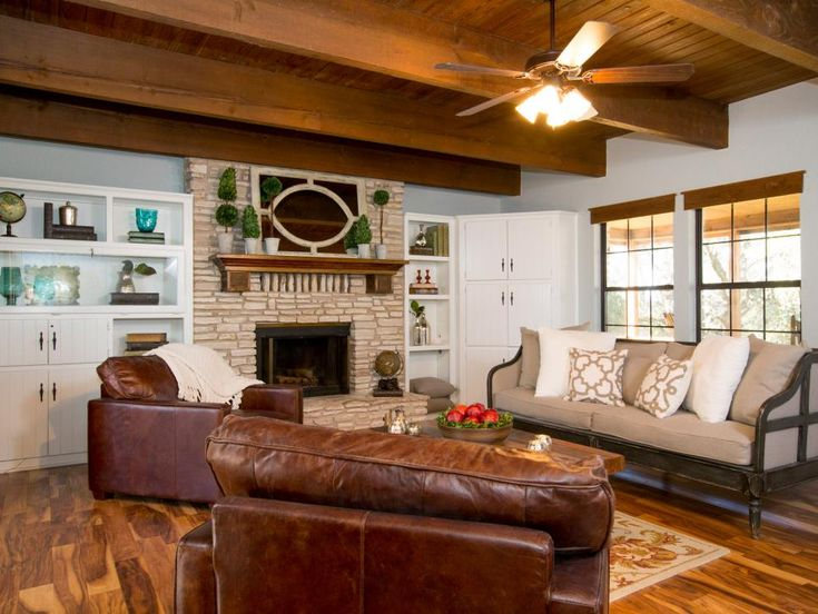 The renovated living room, with new hardwood flooring, exposed beams and leather furniture, blends western country motifs with a mountain lodge feel.