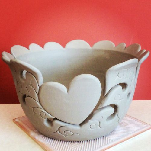 Large unfired heart design yarn bowl. Now what colours shall I glaze this?……