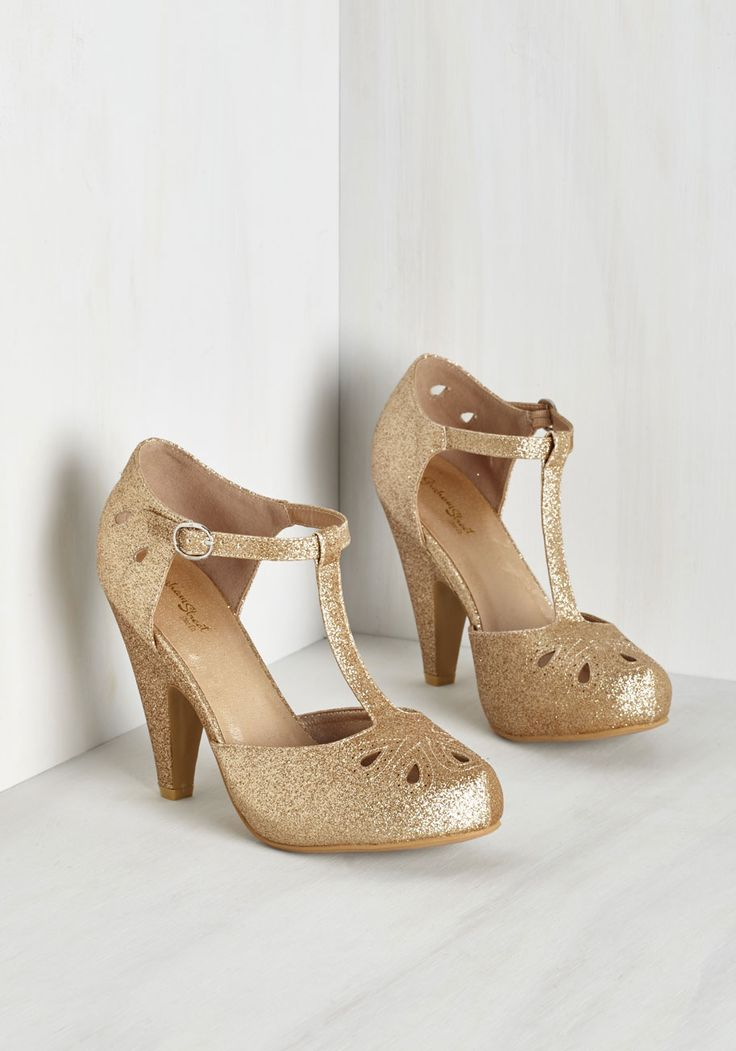 The Zest is History Heel in Glittery Gold. Team these playful T-straps up with your dynamic dance moves and watch as magic unfolds! #gold #modcloth