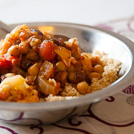 An easy and robustly-flavoured moroccan cauliflower and chickpea tagine.  Comes together in 30 minutes for a delicious vegan meal.