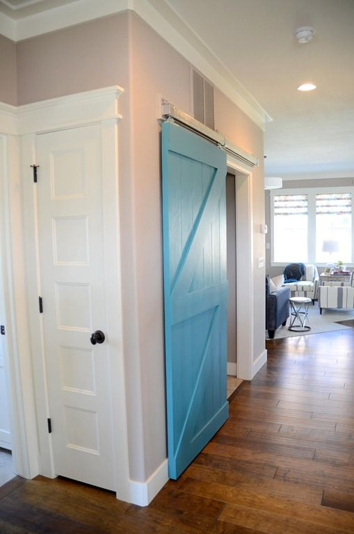 "fantastic barn door...love the placement and color...a barn door into a mudroom...brilliant! Reminds me of what my mom used to say when we would leave the door open...""What ....were you born in a barn!?!?!?!?!?""...said a previous pinner"