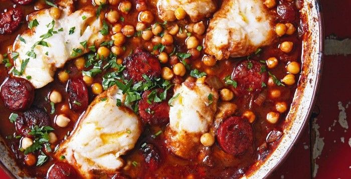 SPANISH COD STEW WITH CHICKPEAS. This combination of rich chorizo with tender chickpeas and flaky cod is deliciously spicy, and comes from the team behind The Great British Bake Off. Find more savoury recipes at housebeautiful.co.uk