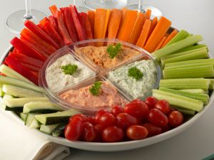 Slices Carrots, Celery, Cucumbers, baby tomatoes... cream cheese dip w/ Cauliflower, green onions, garlic herb