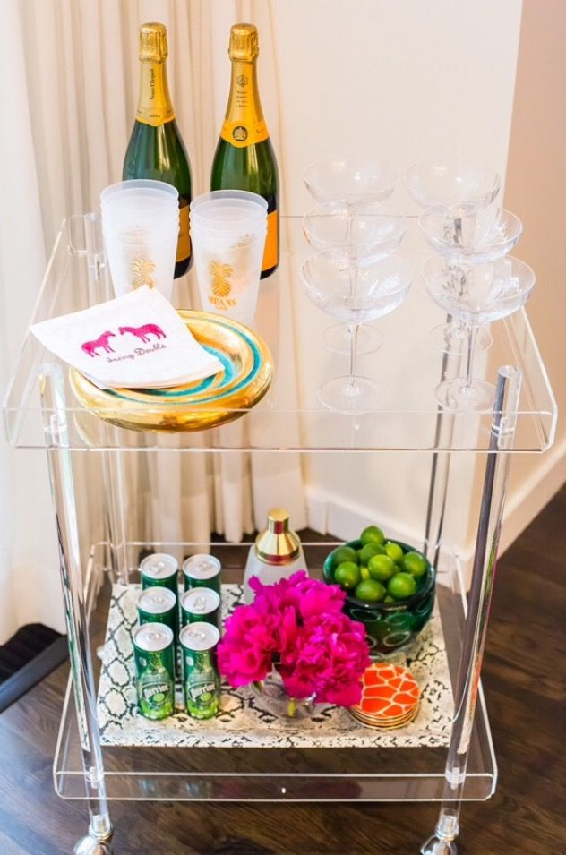 Love the Lucite bar cart