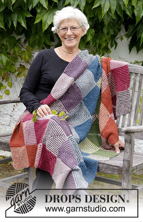 Knitted blanket with domino squares in stripes and garter stitch. Piece is knitted in DROPS Alpaca.