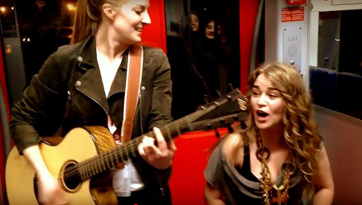 Singers Kiddo Kat and Heidi Joubert who decided to have an impromptu jam session on a Frankfurt train performing Prince's hit Kiss. (video)