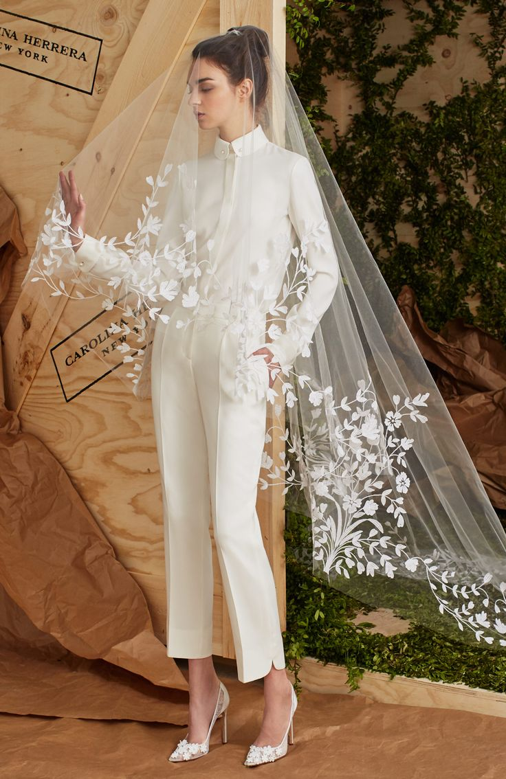 Carolina Herrera wedding suit with embroidered veil