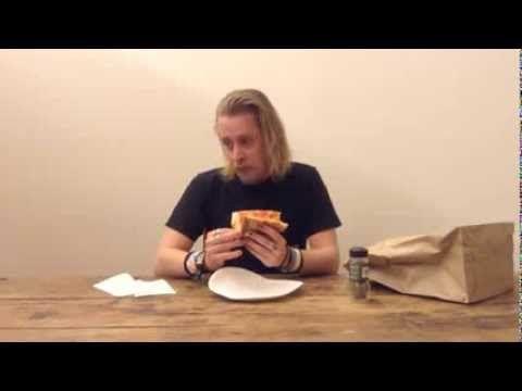 Macaulay Culkin Eating a Slice of Pizza.