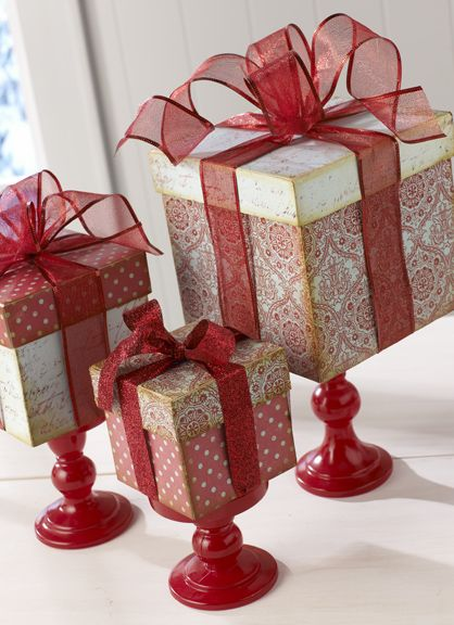 3 paper gift boxes + scrapbook papers + 3 Candle Holders + Modge Podge + Spray Paint + Ribbon + Hot Glue = Pretty Christmas Gift box Centerpiece! Use different color/themed paper to make these for any holiday or occasion
