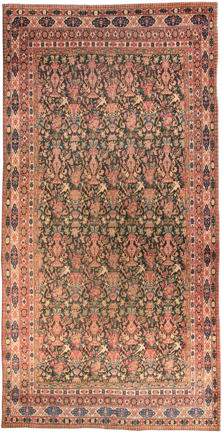 A Persian Kirman carpet BB4584 - by Doris Leslie Blau.  An early 20th century Persian Kirman (Kerman) antique carpet, the dark brown field with neat rows with alternating ...