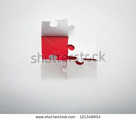 Paper cut of  Puzzle background with copy space for text or design by jannoon028, via Shutterstock