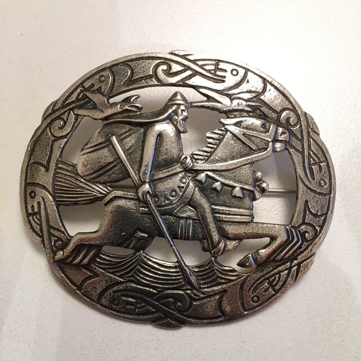 Gustav Gaudernack design for own workshop. Oval silver brooch with motif from viking saga (the god Odin on his horse Sleipner and the ravens Hugin and Munin). 1910-1914
