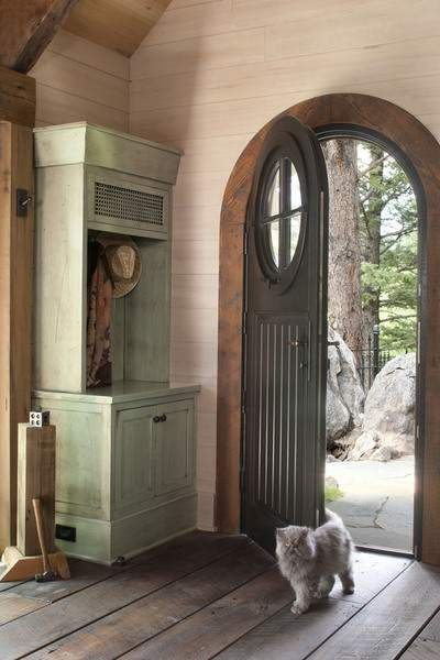 This tiny mountain home in Golden, Colorado, is a small 500 square feet inside. The arched door and round window in the door look so storybook!