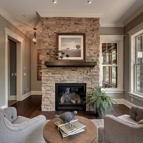 Gray stacked stone fireplace with black hearth design for Grey stone fireplace