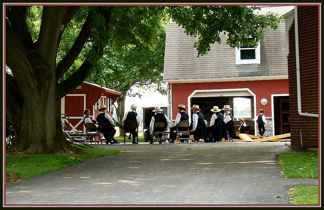 Amish men following a Sunday service