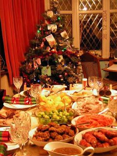 In Britain, the main Christmas meal is traditionally eaten in the early afternoon and often includes: roast turkey or goose, brussels sprouts, roast potatoes, roast parsnips, roast chestnuts, bread sauce, cranberry sauce, rich nutty stuffing, tiny sausages wrapped in bacon (pigs in a blanket), and lashings of hot gravy. For pudding (dessert) rich, fruity Christmas Pudding doused in flaming brandy. A Christmas cracker is placed next to each plate-ready to be pulled to see what suprise falls…