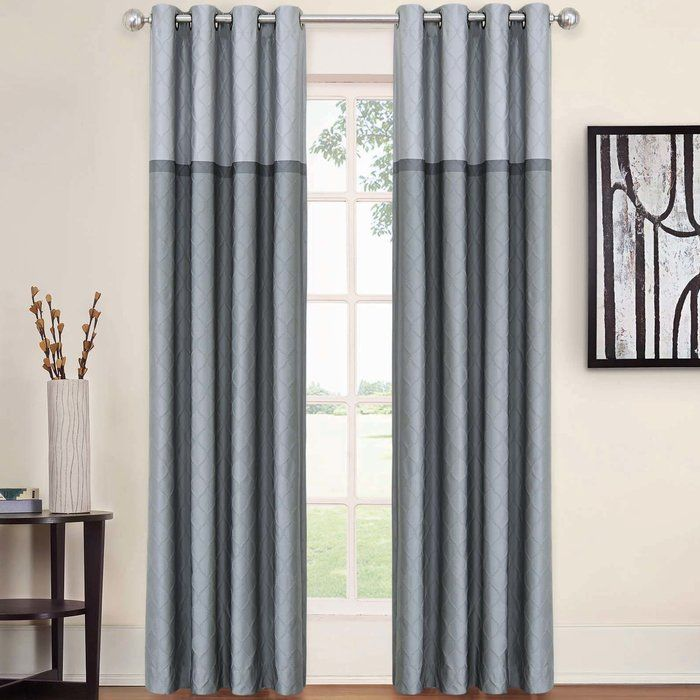 Bring a simple touch of visual intrigue and textural appeal to any space with this essential curtain panel, the perfect piece for aesthetics both traditional and today. Use a pair to bring a dash of definition to your master suite or guest room ensemble. Featuring silver-finished grommets, they're best paired with neutral- and chrome-toned metal rod. Hang them up to let their blackout designs keep the pesky sun out on lazy Sunday mornings, then play off the color-block details and raised ...
