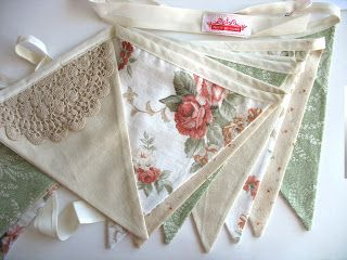 Fabric Flag Bunting. Lace doiley is a nice touch.