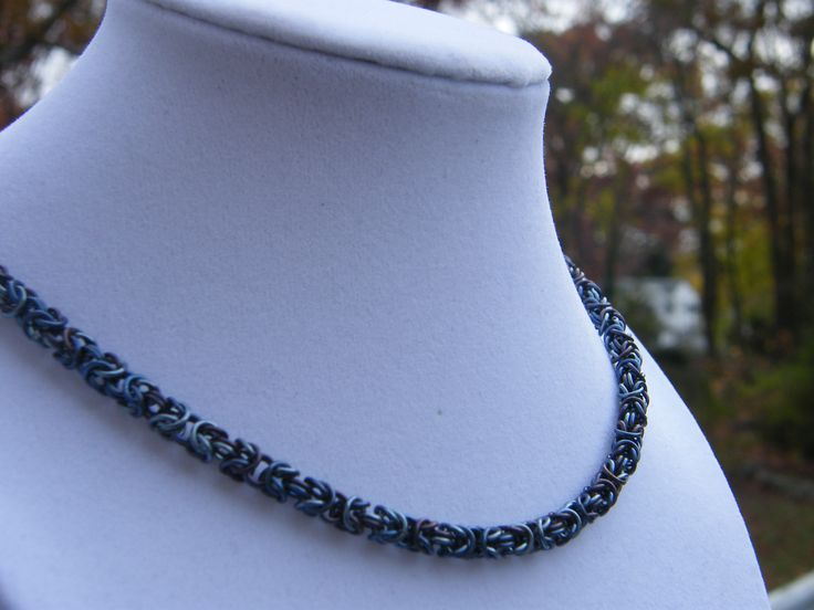 Necklace made for a friend in the navy.  Blend of several different blue shades of anodized Niobium.  Completely compliant with US Navy uniform regulations.