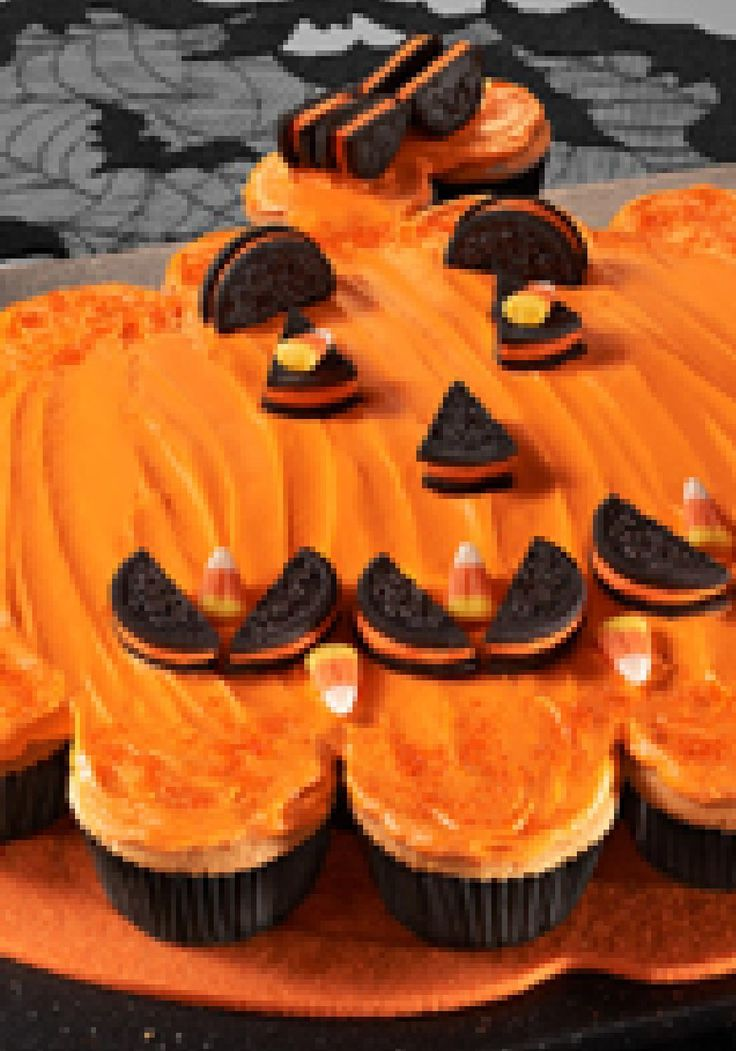 """Pumpkin Pull-Apart """"Cake"""" -- Halloween is all about tricking and treating. Case in point: This yummy pumpkin-shape cake is actually a collection of cupcakes in disguise!"""
