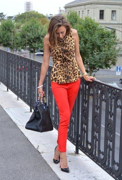 Leopard top , red skinny jeans , black pumps and black handbag