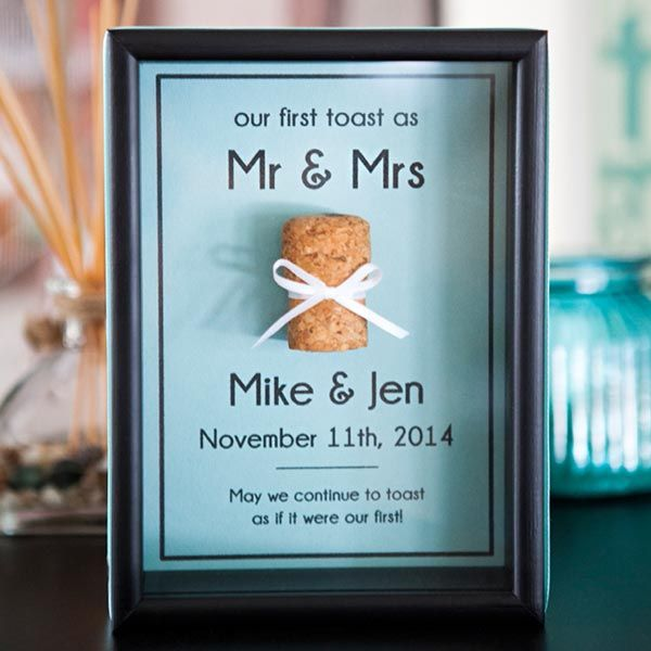 Save the cork from your champagne toast! Display it in a shadow box with this cute printable from Something Turquoise.