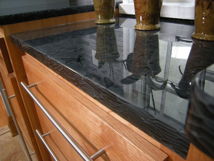 Beautiful recycled glass countertops. When I saw this line I had to use  them in