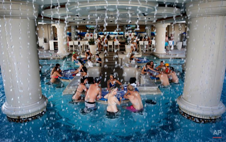 In this Tuesday, July 7, 2015 photo, people play blackjack in a pool at Caesars Palace in Las Vegas. (AP Photo/John Locher)