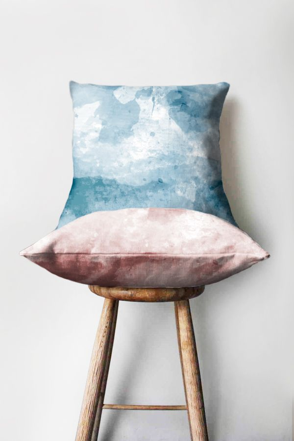 Meridian watercolour printed cushions on a stool in blue and pink