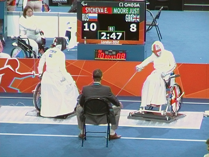 The flashing blades of the women's GB wheelchair fencing team during a bout at the ExCel Centre, Day 9, London 2012 Paralympic Games