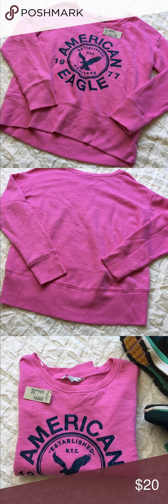 NWT American Eagle Sweatshirt. NWT American Eagle Sweatshirt. Pink with blue graphic. Size medium. American Eagle Outfitters Tops Sweatshirts & Hoodies