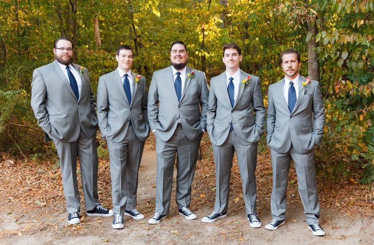 David and his groomsmens looking sharp in light gray suits with navy blue ties. Complete with Converse shoes!