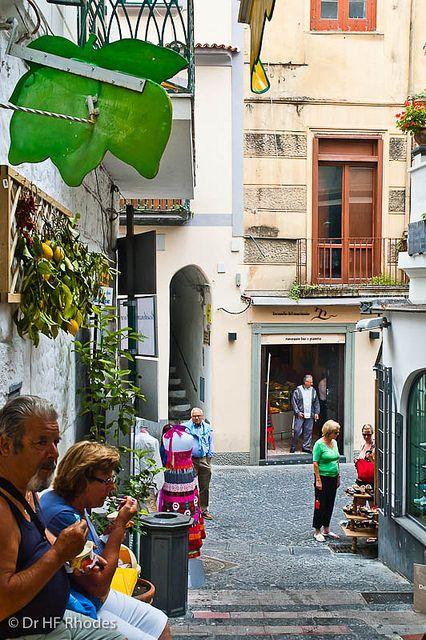 People enjoying gelatos from A'Sciula, famous for lemon ice cream and gelatos, Amalfi, Italy