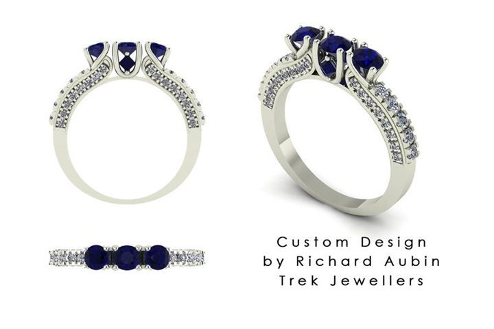 Custom matching band for a customer's own engagement ring. Blue sapphires and diamonds.