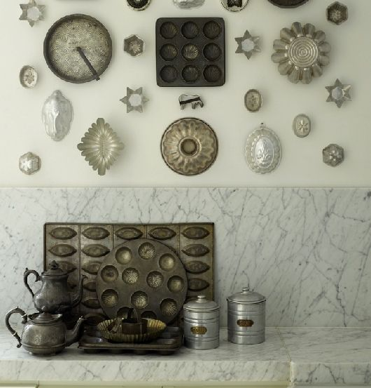 Mount metal cake tins, jelly moulds and pastry cutters in a geometric cluster on your kitchen walls for a striking arrangement.