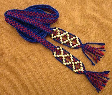 Livonian boy-teen card-woven wool belt with brass decorations. Second half 11th century - first half 12th century Salaspils Laukskola cementery, burrial 322. Tablet woven by Lilita Rašmane