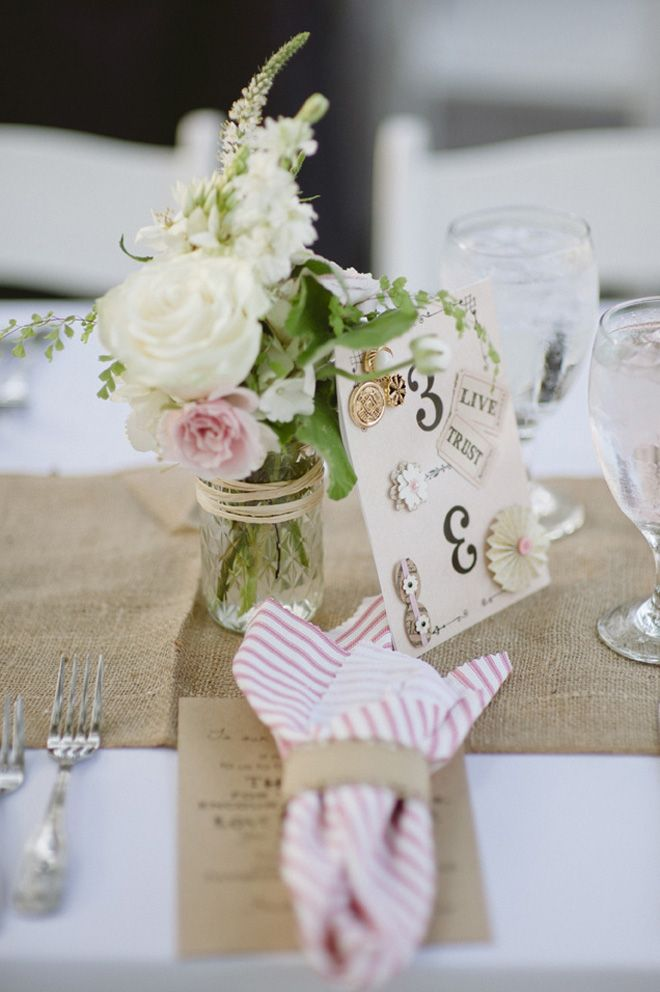 Hessian table runner and flowers in mason jar