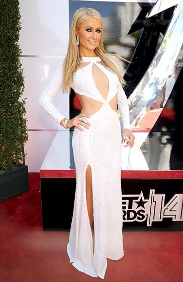 Paris Hilton walked the red carpet at the 2014 BET Awards in a long-sleeved white textured Michael Costello dress.