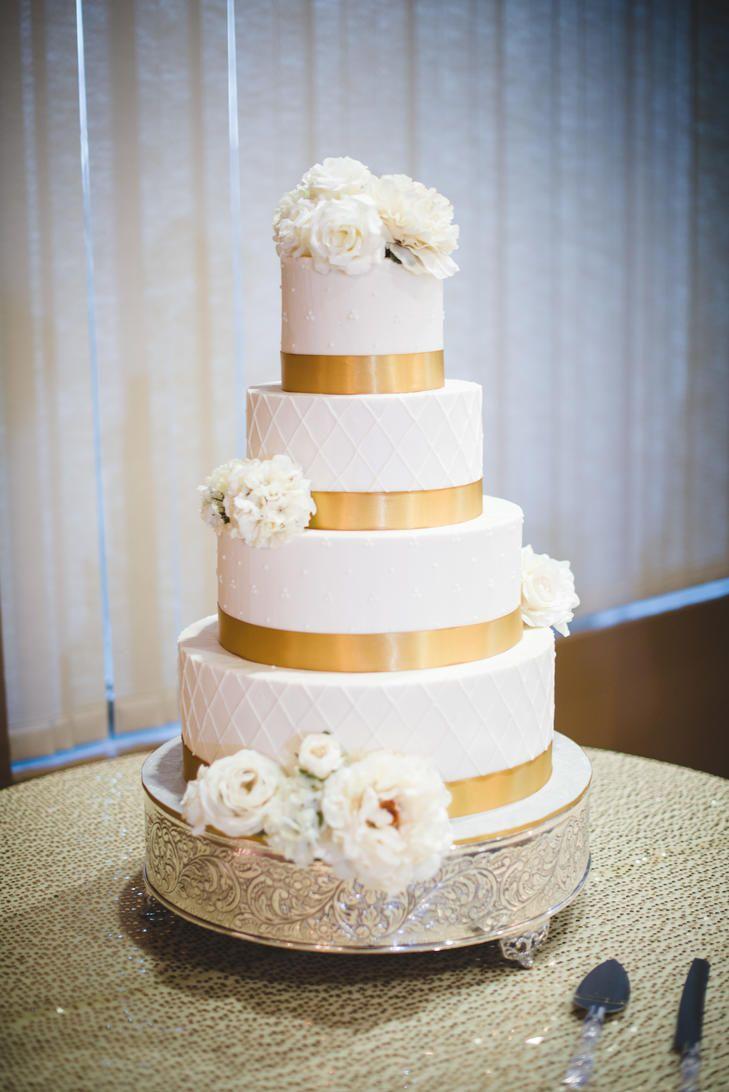 Gold striped wedding cake