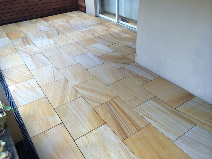 Himalayan teak stone 600mm x400mm pavers installed by HOLLANDSCAPES.