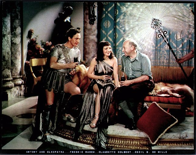"Fredric March, Claudette Colbert and Cecil B. De Mille in Coca Cola ad (photo by Nickolas Muray taken on the set of ""Anthony and Cleopatra"", 1935)"