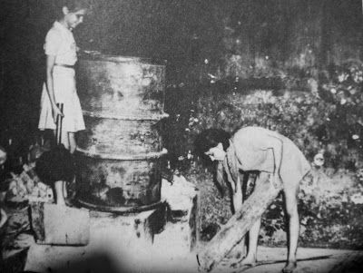 'Now with no teenage boys left in Tjihapit, we girls had to do the heavy work. I remember having to lift the huge food drums in the 'dapur' , or wheel the garbage cart out through the gate...'